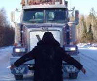 Youth blocking truck