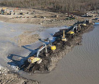 excavators in flood channel